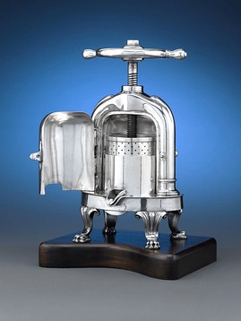 This curious silver plate mechanism by the famed Christofle is known as a duck press, or press à canard, and was once indispensable to French cuisine. ~ M.S. Rau Antiques