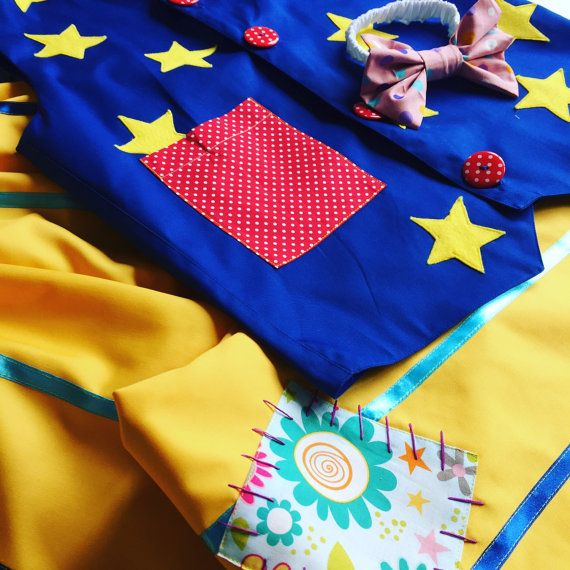 Handmade Mr tumble costume, made to fit person who's going to wear it. Includes trousers, vest , and a sack. As seen in pictures.    Vest- blue cotton with sewn on felt stars  and red pocket. 4 red big buttons. Fully lined.    Yellow trousers- cotton, with two colour blue ribbons and patches sewn and hand stitched on top. Trousers waist elasticated . Also can be made as shorts.can be made in orange fabric if required in advance.    Sack-yellow cotton, all colour circle patches. Size of a…