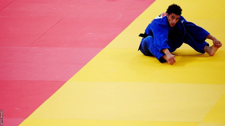 Ashley Mckenzie of Great Britain goes out of the Men's 60kg Judo after losing to Hiroaki Hiraoka of Japan at the ExCeL venue in East London