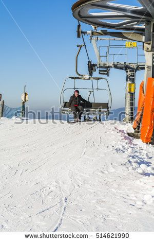 Wierchomla Mala, Poland - January 02, 2016: Snowboarder on the bench chairlift preparing to descend.