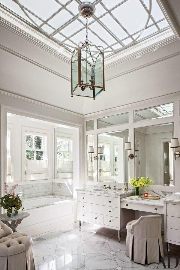 A Circa Lighting lantern and sconces grace the master bath | archdigest.com