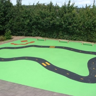 Wetpour Roadway. Is there space for something like this where kids could ride bikes, trikes and scooters?