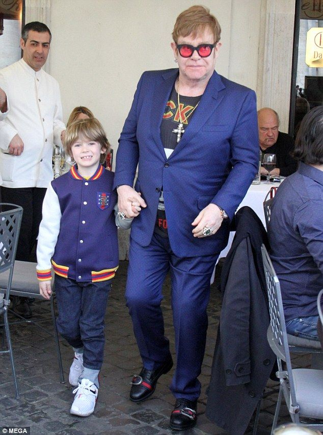 19a8f19c7 Sir Elton John, 70, enjoyed a taste of his soon-to-be life of leisure as he joined  husband David Furnish and their two sons Elijah, five, and Zachary, ...