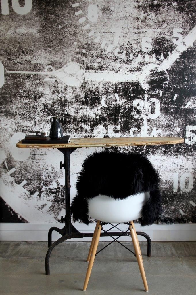Eames Chair, Black sheep skin, Industrial Iron board. Aviator Mural / Scandinavian Wallpaper & Décor. Photography: Gemma Lovitt.