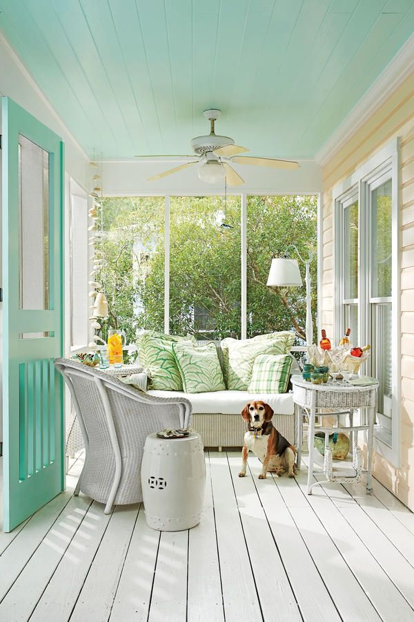 Screened-In Lounge - Tiny Porches and Patios That Are Giving Us Major Inspiration - Southernliving. This comfortable porch is the perfect spot for sipping a glass of wine on a breezy, warm evening.