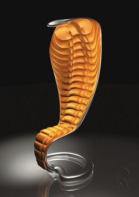 voor de slangen liefhebber is er een stoel in de vorm van een slang. kijk op http://eetkamerstoelen365.nl voor meer stoelen.