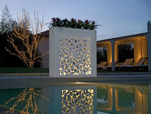 Flower pots! Difficult to water, but quite striking and add a lot of visual interest to an outdoor area.