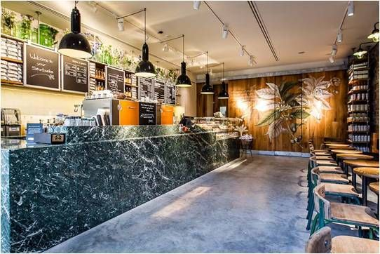 One of six Starbucks stores in Amsterdam, the centerpiece of the design is a large, green marble counter top which summons the grandeur of traditional canal houses.