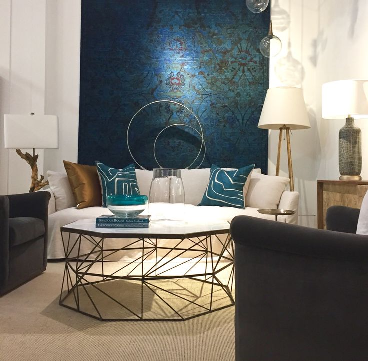 slipcovered neutral sofa and teal accents. #insidecocoonfurnishings #roomscene #cocoonshowroom