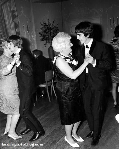 George Harrison & Ringo Starr dancing with their mums at the premiere party for their film, 'A Hard Day's Night,' directed by Richard Lester, at the Dorchester Hotel, London.