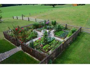 Fresh Formal garden with a fence perfect for vegetables Gravel walking paths with a central urn Very organized