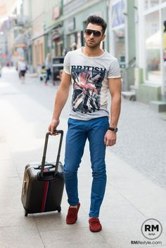 Shop this look on Lookastic: lookastic.com/... Dark Brown Sunglasses Grey Print Crew-neck T-shirt Black Leather Watch Blue Chinos Burgundy Suede Driving Shoes