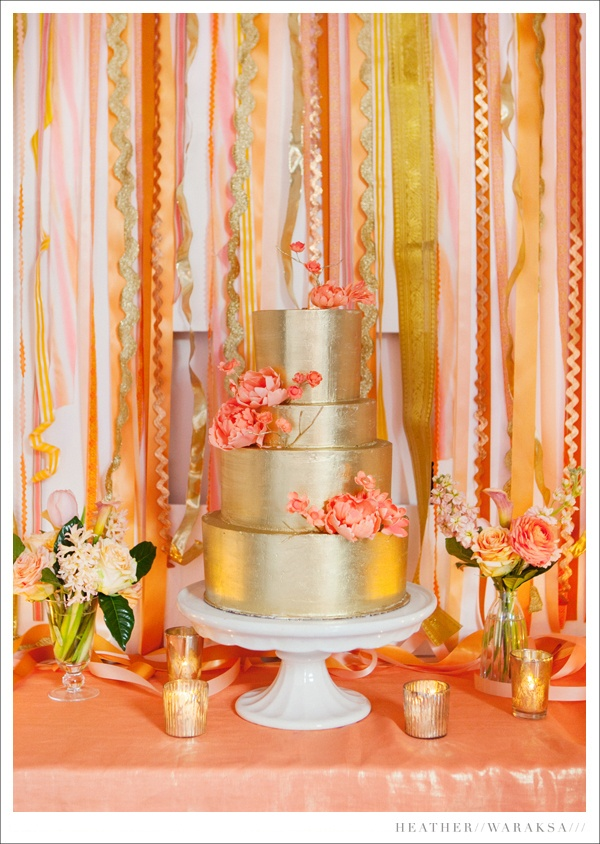orange yellow peaches gold wedding cake and table by heather waraksa photography
