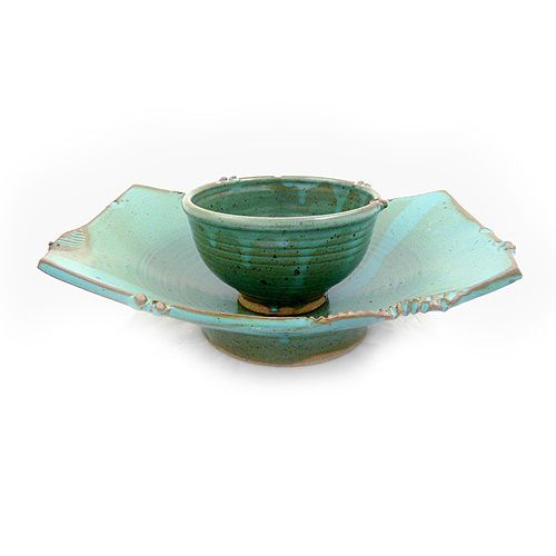 Asian-Inspired Stoneware Pedestal Serving Dish in Teal. Ideal for an endless variety of serving ideas, the set includes a curved pedestal dish and separate rice/dip bowl, which may be used in the center of the dish or set aside. Sculpted from high-fired ceramic stoneware, the serving dish is durable, chip-resistant, lead-free, food-safe, and oven/microwave/dishwasher safe. Handmade in North Carolina.
