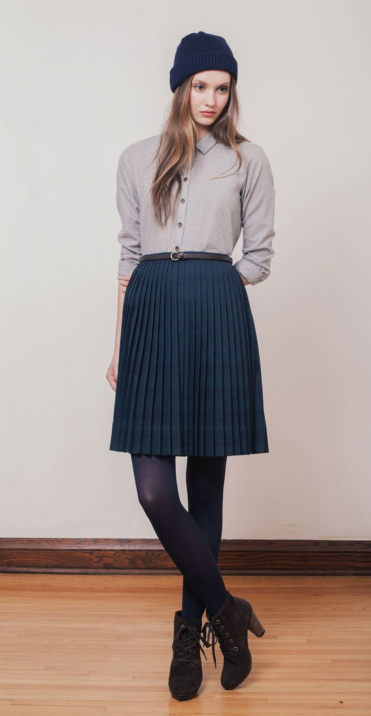 JILL Heather Grey: Long-sleeved blouse in soft, comfortable Japanese cotton flannel. CAILA Navy Tartan: High-waisted accordion pleated skirt in tartan pattern. TAMY Navy: Hat in Italian merino wool knit in Montreal. Betina Lou Fall-Winter 2014-15.