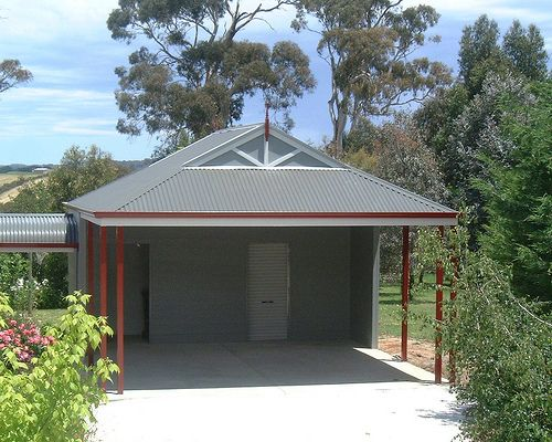 Storage shed with carport sheds carports and awnings for Attached garage kits