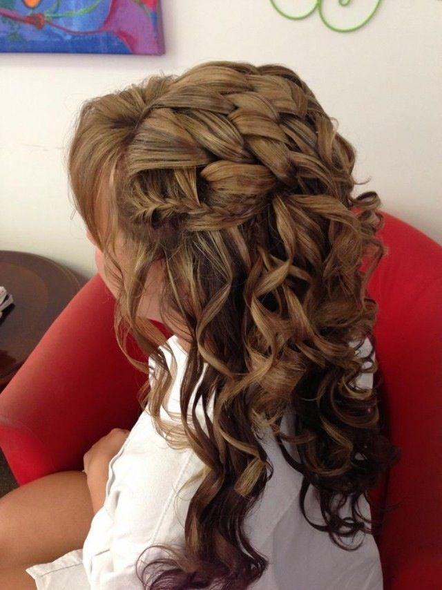 complex, but stunning half up half down hairstyle with curls