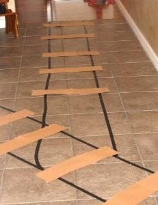 Children love becoming a part of the action, so we took the time to transform our home into an unforgettable adventure! Black electric tape and brown construction paper became tracks