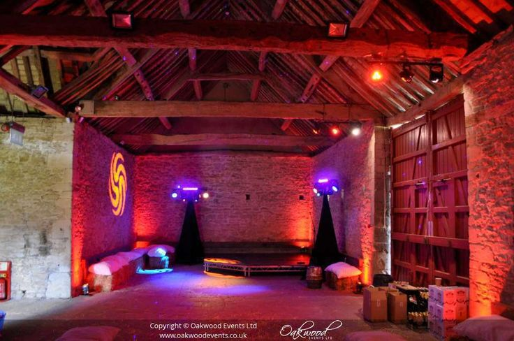 Beam lights, disco lights, and uplighting in the Barley Barn at Cogges