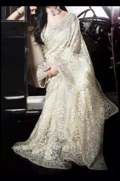 stunning white sari along with cream hues with exquisite floral work