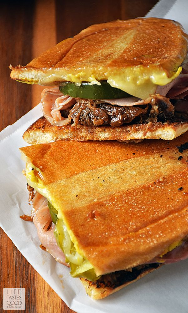 No need to travel to South Florida to enjoy a Cuban sandwich. Make this Pulled Pork Cuban Sandwich | by Life Tastes Good at home using leftover pulled pork, fresh homemade pickles, your favorite ham and cheese, and soft, fresh baked bread from the bakery. It's easy and full of flavor! #LTGrecipes