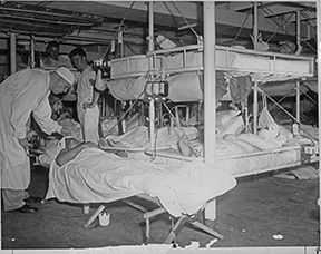 Pearl Harbor.  Burned and injured patients receive care aboard the USS Solice.