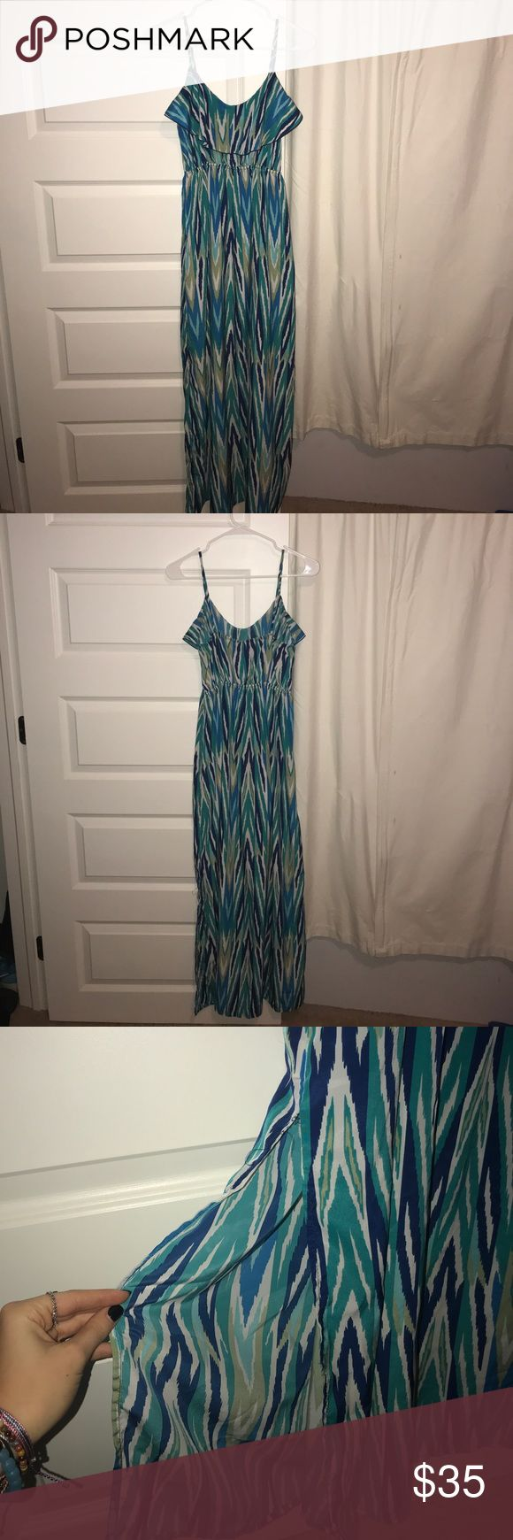 Comfortable, and silky Maxi Dress Originally brought for $50 from Von Maur. One of my absolute favorite dresses! Would be super cute as a beach dress, date night dress, family or friend birthday party dress! Hugs the chest and flows down. Also the slit in the dress is a little worn towards the top Soprano Dresses Maxi