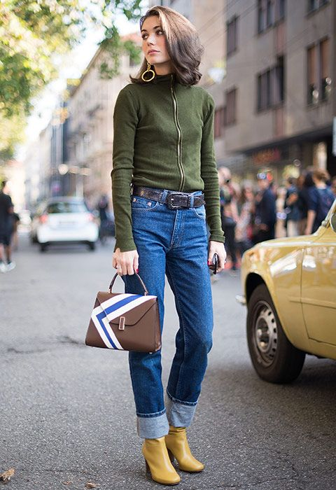 Hit refresh on your 501s by working them with a turn-up. For all the throwback feels, go for an earthy colour palette (e.g. khaki knit, yellow boots and brown ladylike bag), then add gold dangly earrings