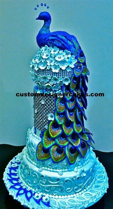 Amazing Blue on Blue Peacock cake with hand painted feathers ~ all edible - what artistry!