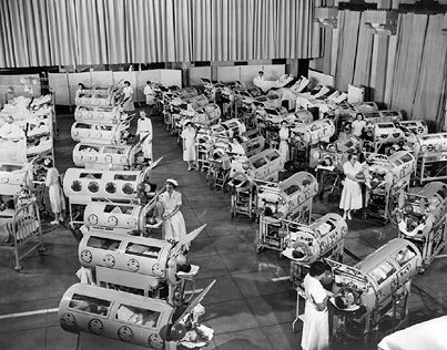 At first glance, this image shocks and saddens from the enormity of the problem of sick children in need of iron lungs. On closer examination, it is clear that the equipment that usually accompanied people using iron lungs, such as tracheotomy tubes and pumps and tankside tables, is not present (compare the picture to photographs in the section on the iron lung). This scene was staged for a film.