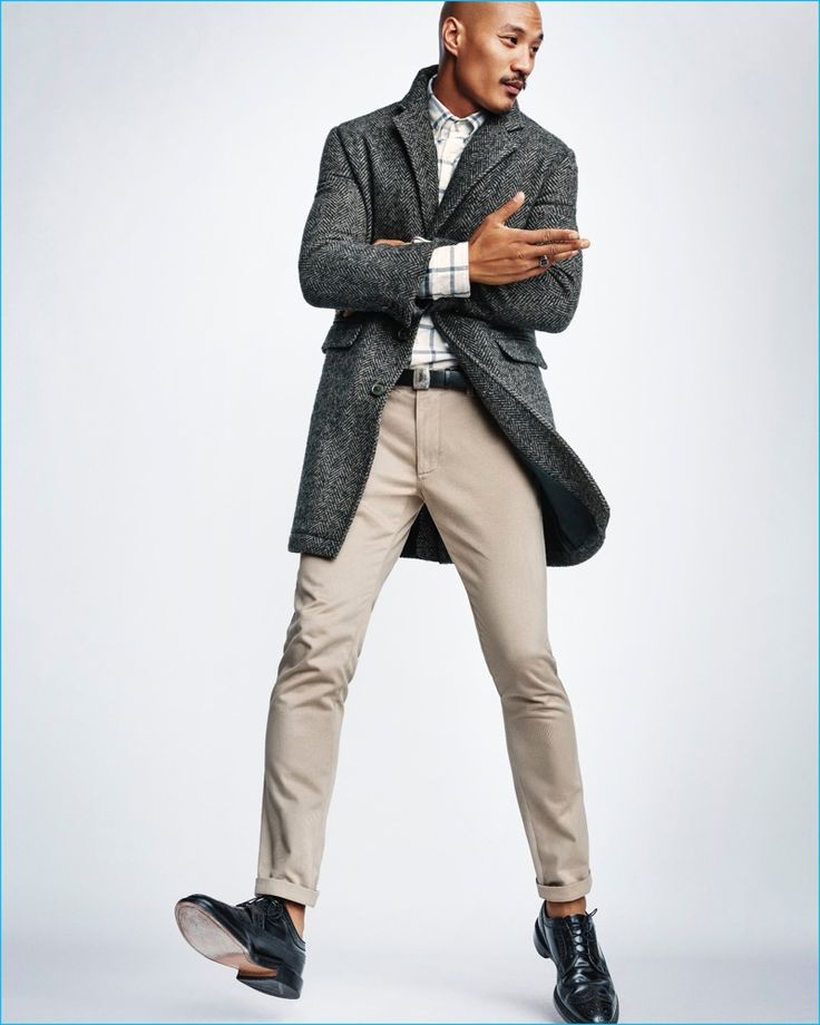 Paolo Roldan pictured in a single-breasted coat, check shirt, and khaki pants from Steven Alan for Gap x GQ's Best New Menswear Designers in American All-Stars limited-edition collection.