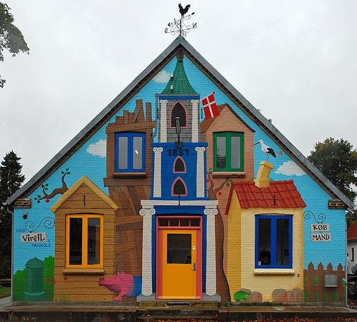 "Little Virgil's village, Ove | Denmark (by Franco Coluzzi) Mural painting on the facade of a primary school, inspired by Ole Lund Kirkegaard's ""Little Virgil"", a classic danish children's book. The school has taken its name from this novel."