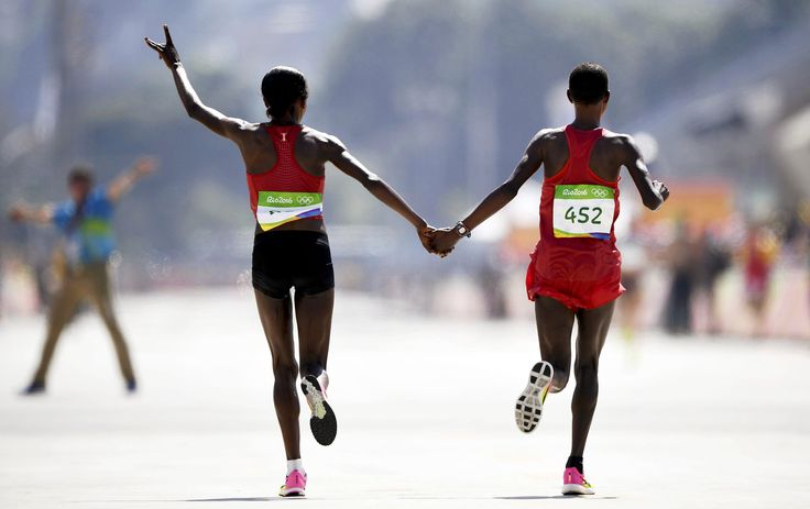 Jemima Sumgong of Kenya, left, the women's marathon winner, and the silver medalist Eunice Jepkirui Kirwa of Bahrain.  Dylan Martinez/Reuters