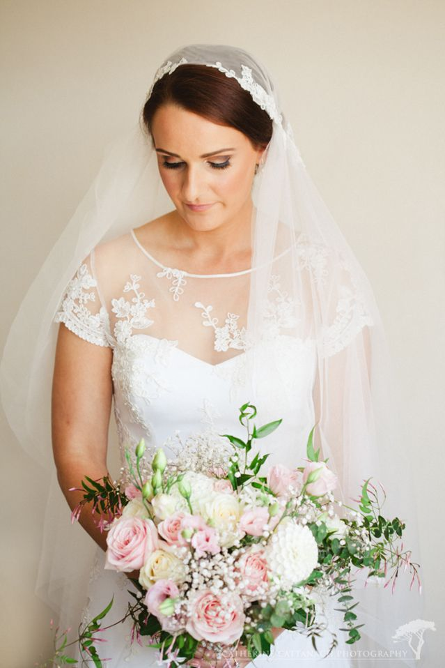 Janelle wearing her custom Sophie Voon veil and lace dress
