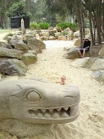 The Bilarong Reserve at North Narabeen has fenced & shaded playground for toddlers, climbing spider nets for older children & an awesome constructed dry creek sand pit with rock sculptures of mythical creatures like dragons and lizards!