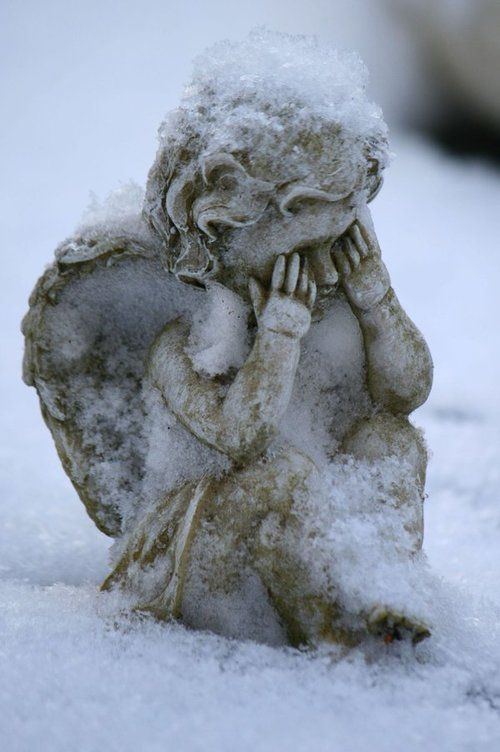 Cherub in the snow……..DO NOT FRET LITTLE CHERUB 'CAUSE SPRING IS JUST ABOUT TO BURST ALL OVER AND THOSE TEARS WILL BECOME AN UP-TURNED SMILE FULL OF HAPPINESS………….ccp