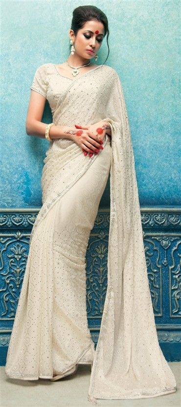 118353: White and Off White color family Saree with matching unstitched blouse.