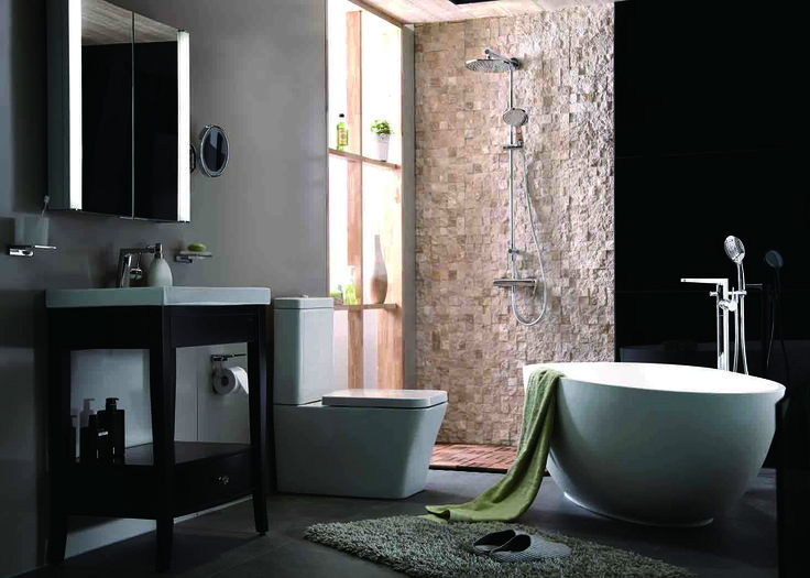 A bathroom with solid surface freestanding bathtub, wash stand, and square toilet
