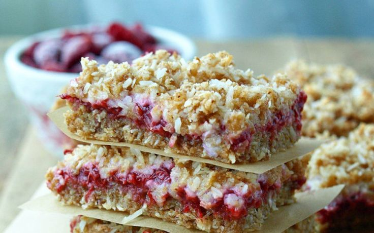 Introducing the tastiest, jammiest, most crumble-topping-est (just go with it), sweet dessert bar, ever. Who can resist the wonderful sour taste of rhubarb? Especially when balanced with the sugary sweetness of raspberry and coconut. The crisp and crumbly texture of these mouth-watering bars makes them the perfect fit for a sweet-tooth's breakfast, a mid-day pick-me-up snack, or dessert!