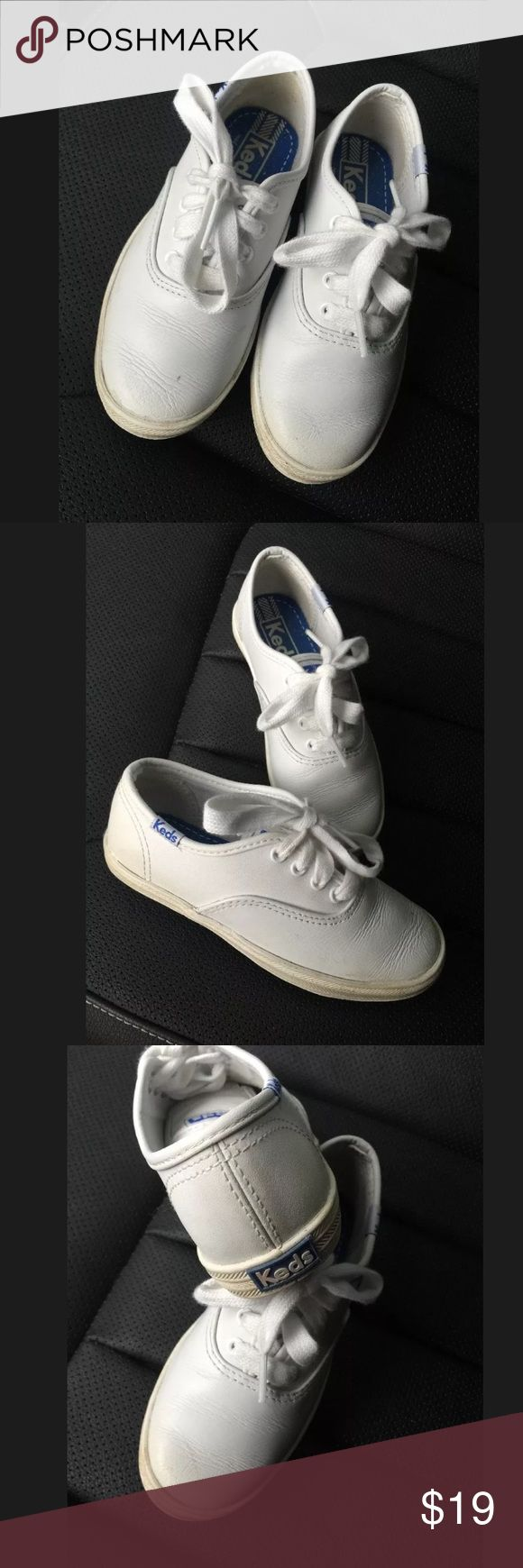 Girls champion white leather keds Sz 10.5 Fantastic pair of classic champion white leather sneakers !  Girls size 10.5 My daughter only wore these twice before she had a growth spurt. They should clean up just fine to looking almost new    Smoke/pet free home Keds Shoes Sneakers