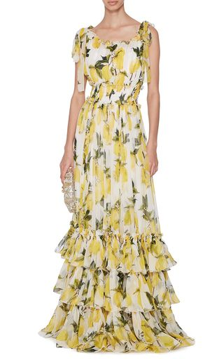 Italy's most renowned design duo use their intricate, finely crafted collections to celebrate a spirited vision of womanhood. This **Dolce & Gabbana** dress features a vibrant lemon print and layered ruffled hem for a fresh take on femininity.
