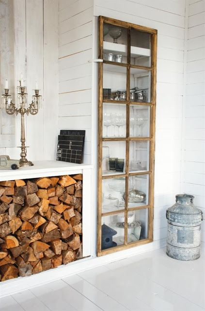 Love the Window covering builtins and wood storage below cabinet.