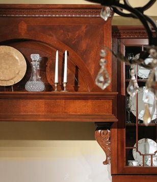 Detail of custom mahogany hood and glass mullion doors in a Traditional Kitchen design