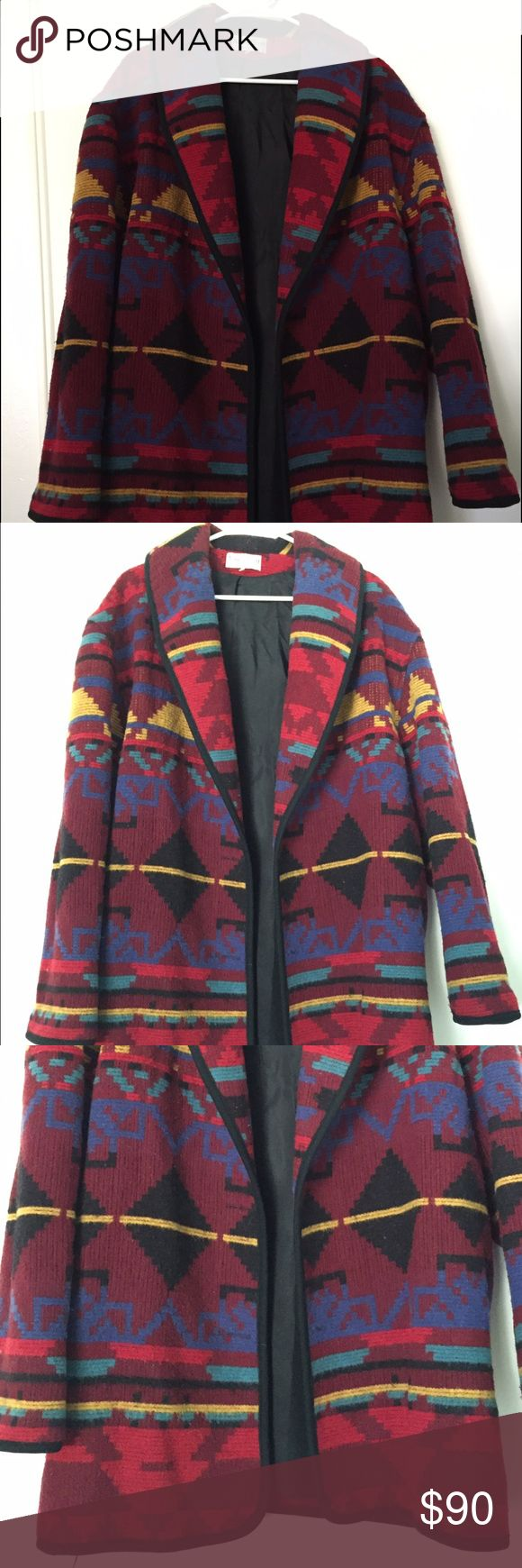 Ashley Scott coat Vintage Tribal pattern coat. It's lined on the inside. 85% wool 15% nylon. Dry clean only. Great condition but it is missing the front buttons. Doesn't seem to really need them, unless you want to button it up. I'd say it's a size Large/ XL. Made in the USA ashley scott Jackets & Coats Pea Coats