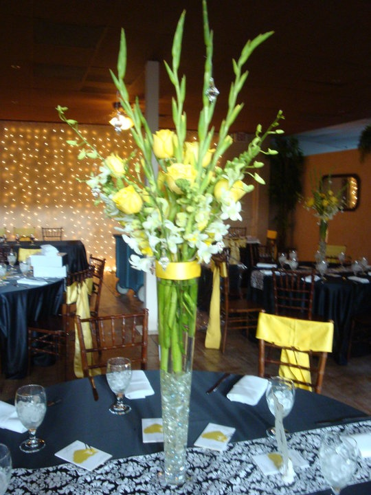 Tall flute centerpieces with floral arrangements done by