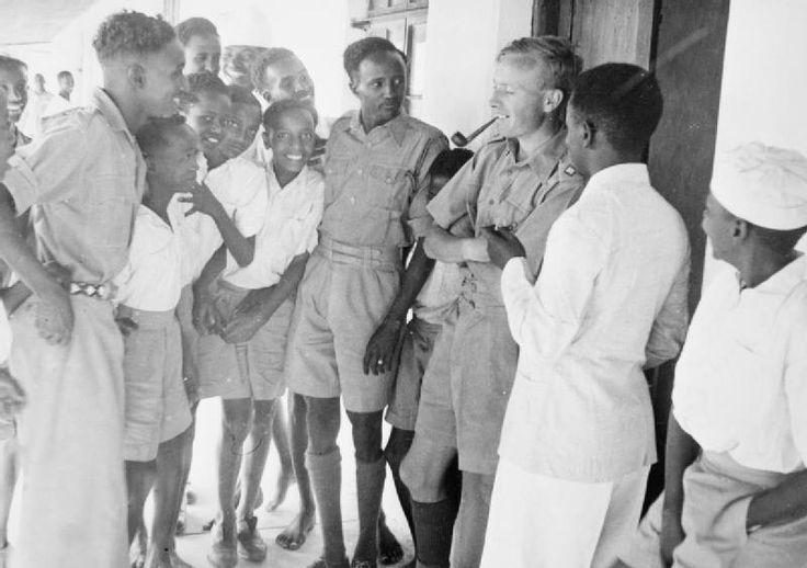 "Lieutenant Lloyd of Maidenhead, an English master at Sheikh [British boarding school), talking to students during ""break"" in wha..."