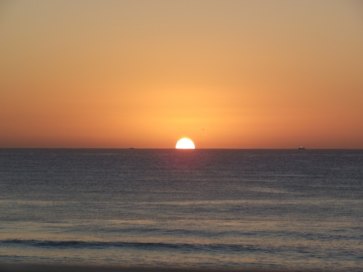 Slowly the sun appearing on the horizon at St Francis Bay