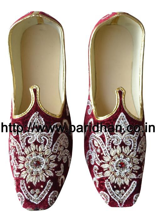 Royal look wedding mojari made in maroon color uncrushable velvet fabric and thin synthetic sole. These are Handmade Men Wedding Mojari Jutti. They will take the shape of the feet as you wear them. Both shoes in a pair are identical. They will take the shape of the feet as you wear them. Upper Made from maroon color velvet fabric. They have curved toe to give them a traditional and Royal Look. These khussas are made of Flat and thin synthetic soles. Handcrafted by the shoe makers of ...