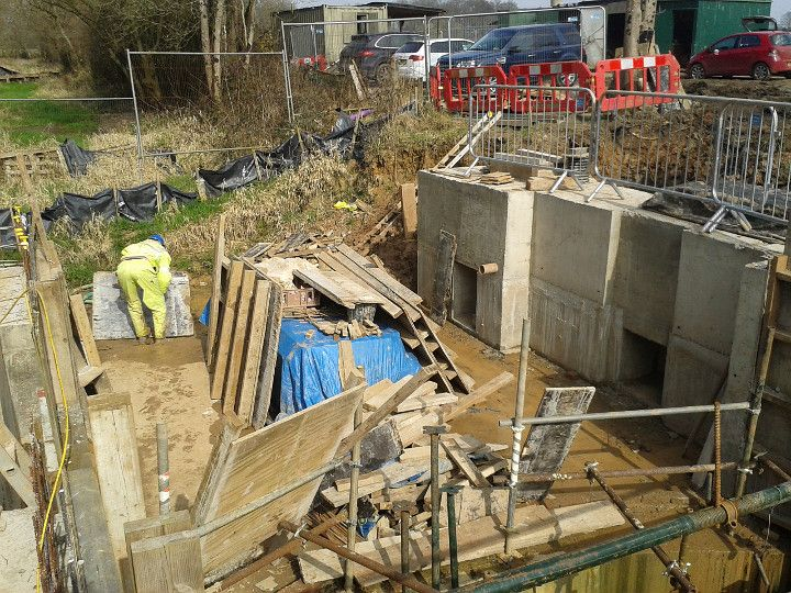 Construction of Gennets Bridge Lock. The concrete casting for the upper offside cill is now complete, with the paddle culvert to the right and the back pumping culvert to the left. The bare concrete will be clad in bricks in the same way as the main chamber walls.