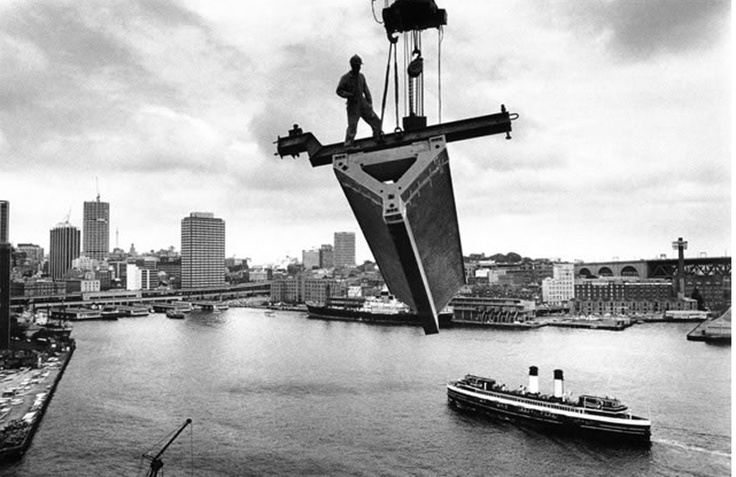 Lifting a roof section over Sydney Harbour, 1967.